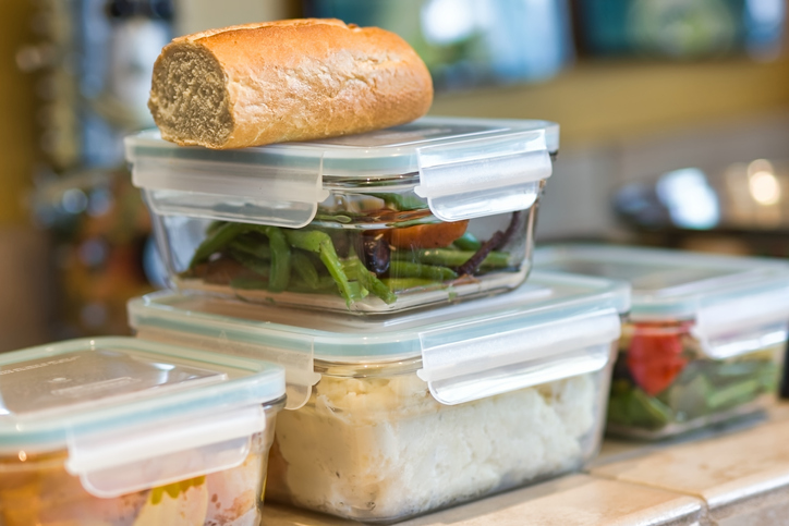 Food leftovers stored in stacked glass containers.
