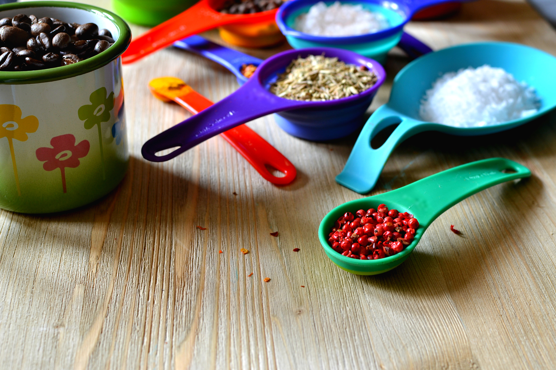Kitchen measuring set filled with colorful ingredients.