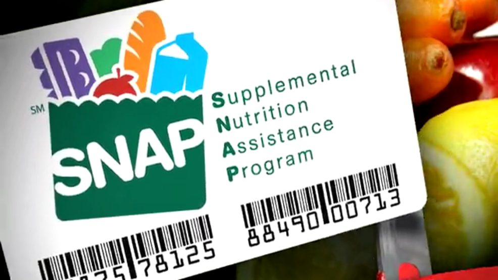 smaple Virginia SNAP EBT benefits card in front of fresh produce