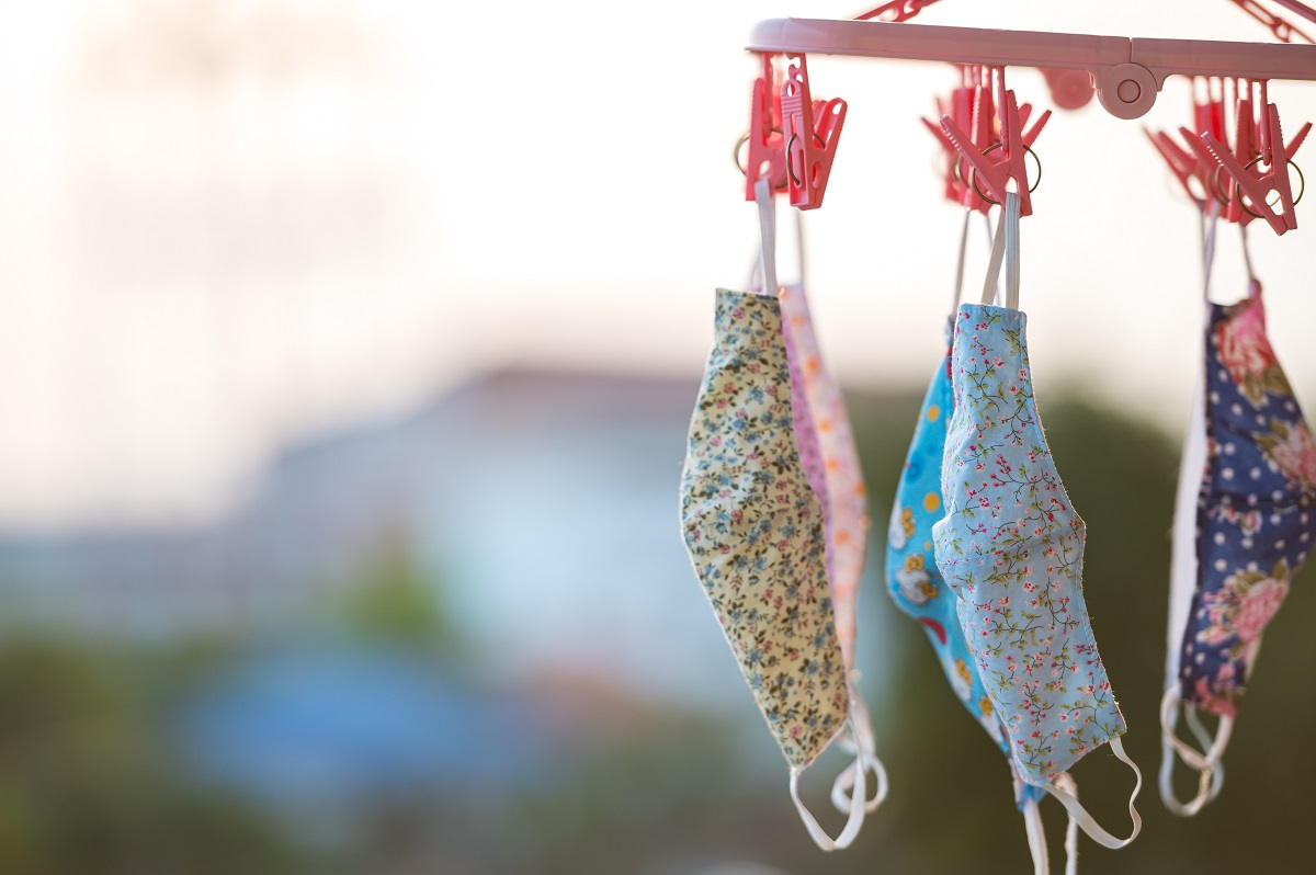 reusable face masks drying on the line after being laundered