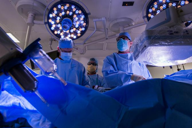 Carilion cardiac surgeons performing procedure in operating room