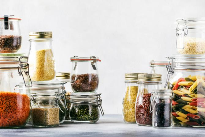 Dried beans, grains and pasta in glass jars.