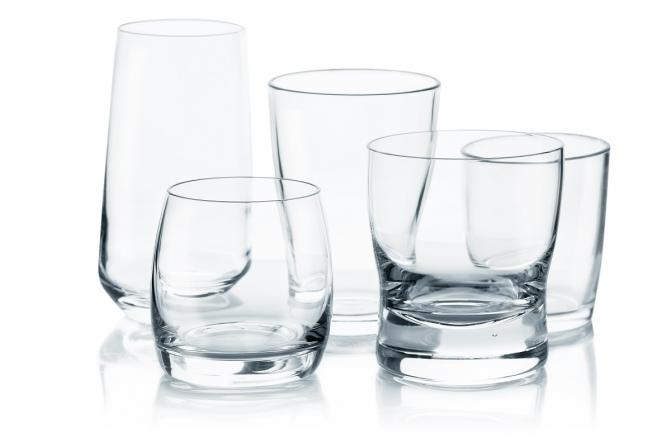 empty glasses of various sizes indicating different types of alcohol
