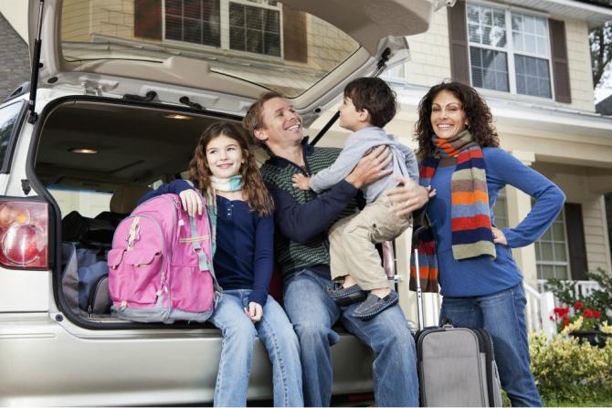family getting ready to go on a road trip