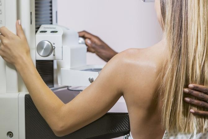 cropped image of woman receiving mammogram