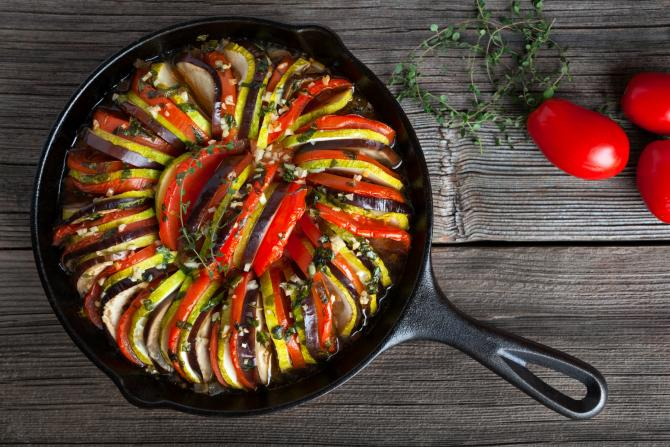 cast iron skillet full of delicious squash, zuchinni, tomatoes