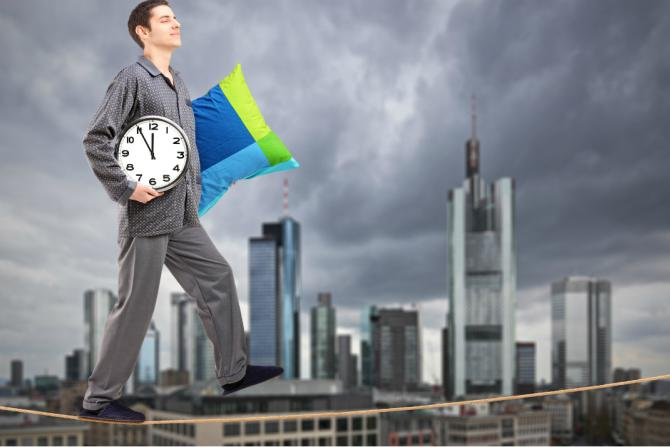 man walking on a tightrope in pajamas holding a clock and a pillow