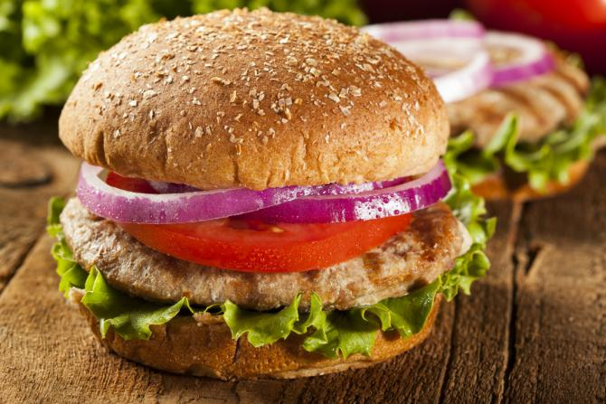 turkey burger on whole wheat bun with lettuce, tomato and onion