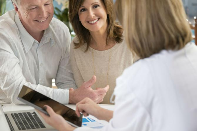 man amd women talking with doctor about fertility options