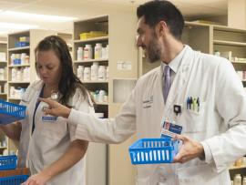 Two Carilion Clinic pharmacists work together to fill thousands of prescriptions for patients at Carilion Roanoke Memorial Hospital.