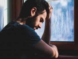 Depressed man looking sad