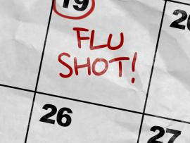 flu shot written on calendar