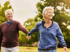 senior couple holding hands and enjoying a walk
