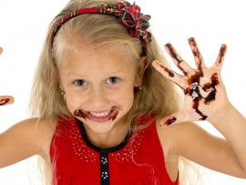 Girl with chocolate-covered hands.