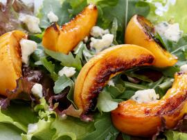 Enjoy a peach, arugula and goat cheese salad.