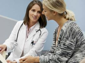 female patient talking to her urogynecologist about incontinence