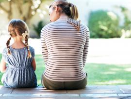 Mom young daughter talking porch bullying