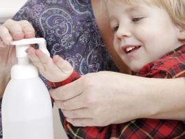 Mother and son washing hands_Recent uptick in stomach virus cases