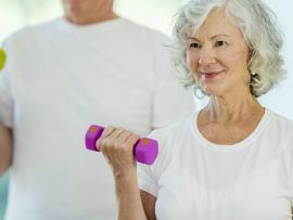 woman exercising with small hand weight
