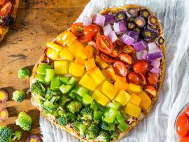 flatbread pizzas topped with a colorful assortment of vegetables