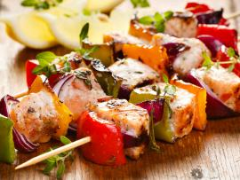 Kebabs with veggies and salmon make a healthy meal.