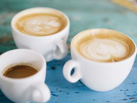 Three cups of coffee on blue table_Will your coffee habit help you live longer