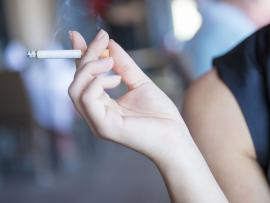 Woman holding cigarette_Snuff out the smoking habit