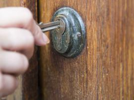 Woman locking front door_sexual assault tops on staying safe