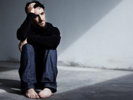 young man sitting down dealing with extreme anxiety