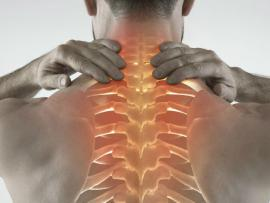 man with back pain, picture shows inflamed spine