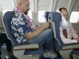 Man crammed into tiny plane seat