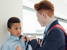 older child bullying younger student at school