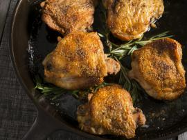 chicken thighs in a cast iron skillet
