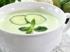 a bowl of creamy, chilled cucumber soup