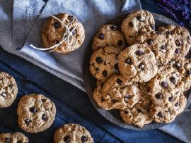 chocolate chip cookies on a plate and cooling on a rack