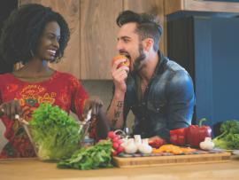 young couple making a healthy salad in kitchen
