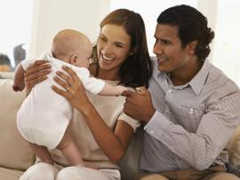 couple playing with their baby