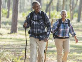 older couple hiking empty nest autumn