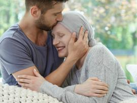 man hugging woman with cancer during her end of life care
