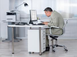 office worker with poor posture at workstation