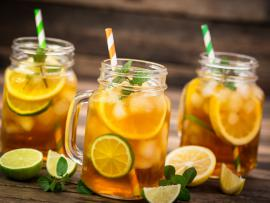 three glasses of iced green tea with lemon lime mint