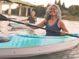 healthy senior paddling and enjoying life