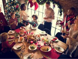 friends and family enjoying food at a holiday party
