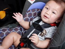 baby about 6 months old in rear facing car seat