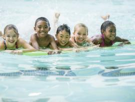 group of kids enjoying swimming at the pool