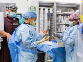 neurosurgery reisdent preparing for surgery