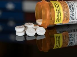 bottle of opioids spilled on counter