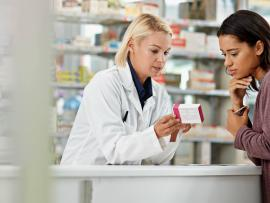 Talking to a pharmacist about medication prescription