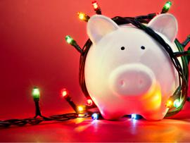 piggy bank with holiday lights wrapped around it