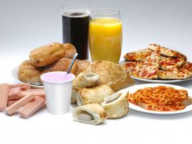 processed foods such as doughnuts, pizza, soda, spaghetti-os